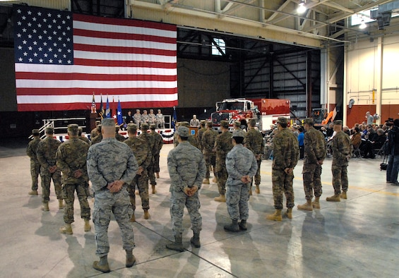 Airmen from the 142nd Fighter Wing Civil Engineer Squadron take part in a formal mobilization ceremony, March 1, 2014, held at the Portland Air National Guard Base, Ore. (Air National Guard photo by Tech. Sgt. John Hughel, 142nd Fighter Wing Public Affairs/Released)