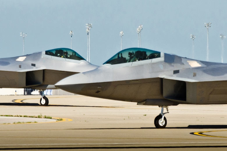 Two U.S. Air Force F-22 Raptor fighter jets taxi into the Kentucky Air National Guard Base in Louisville, Ky., on April 18, 2012. The Raptor Demonstration Team is set to appear in the 2014 Thunder Over Louisville Air Show. (U.S. Air National Guard photo by Maj. Dale Greer)