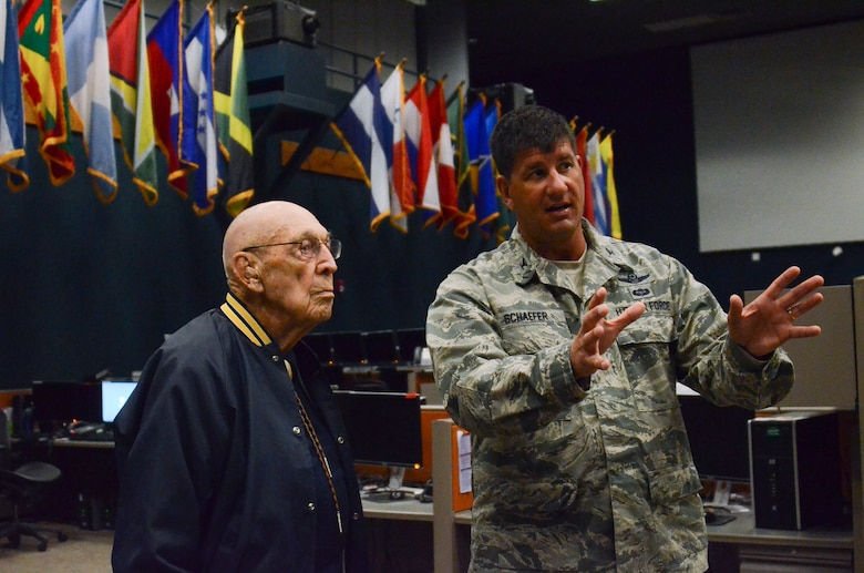 Col. John Schaefer, command of the 612th Air and Space Operations Center, gives a tour to Lt. Col. Richard Cole, a retired Doolittle Raider, on Davis-Monthan AFB, Ariz., Feb. 25, 2014.  The 612th AOC provides command and control of air and space power in United States Southern Command's area of responsibility that include 31 countries. The building was named the James H. Doolittle Center in honor of the Doolittle Tokyo Raiders.