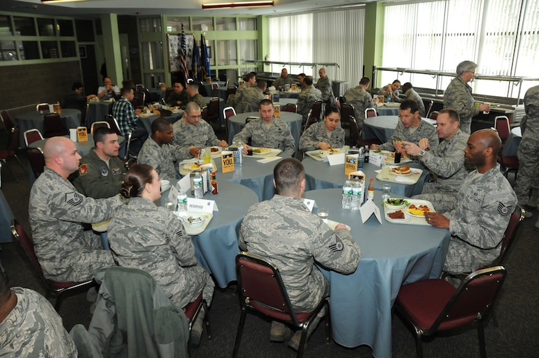 The Director of Air National Guard, Lt. Gen. Stanley E. Clarke, III and Col. Timothy J. LaBarge, commander 105th Airlift Wing meet with enlisted members durning a unit training assembly lunch in the dining facility at Stewart Air National Guard Base, N.Y. March 2, 2014.  (U.S. Air National Guard photo by Tech. Sgt. Lee Guagenti/Released)
