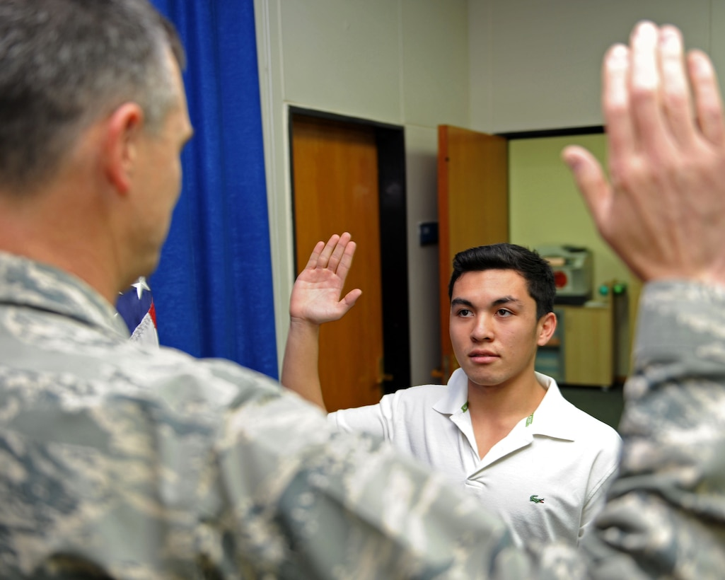 Ruben Gawan, son of Chief Master Sgts. Lori and Phillip Gawan, takes the oath of enlistment Nov. 2, 2013, Incirlik Air Base, Turkey.  After 19 years of traveling around the globe with his parents as a military dependent he has decided to enlist in the Air Force. (U.S. Air Force photo by Senior Airman Chase Hedrick/Released)