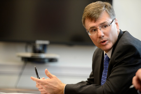 """Dr. Troy E. Meink, the deputy Under Secretary of the Air Force for Space, answers questions during a space budget briefing March 5, 2015, at the Pentagon. Meink discussed the Air Force's commitment to competition, finding cost-effective measures, and fielding capabilities to address concerns of a growing """"contested environment."""" (U.S. Air Force photo/Scott M. Ash)"""