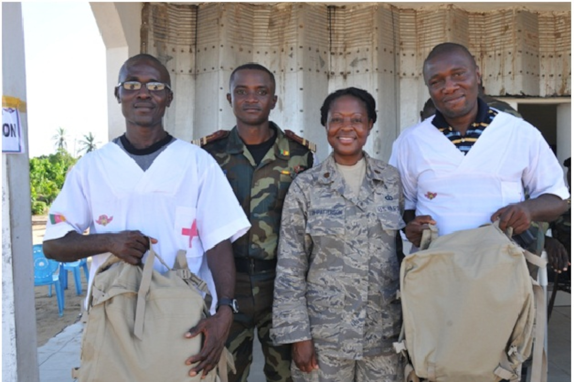 Maj Angelique Vann-Patterson, U.S. Air Forces in Europe - Air Forces Africa international health specialist, with Cameroonian army officer and civilian Health Care Workers during humanitarian civic assistance activities in Manouka, Cameroon. (Courtesy photo)