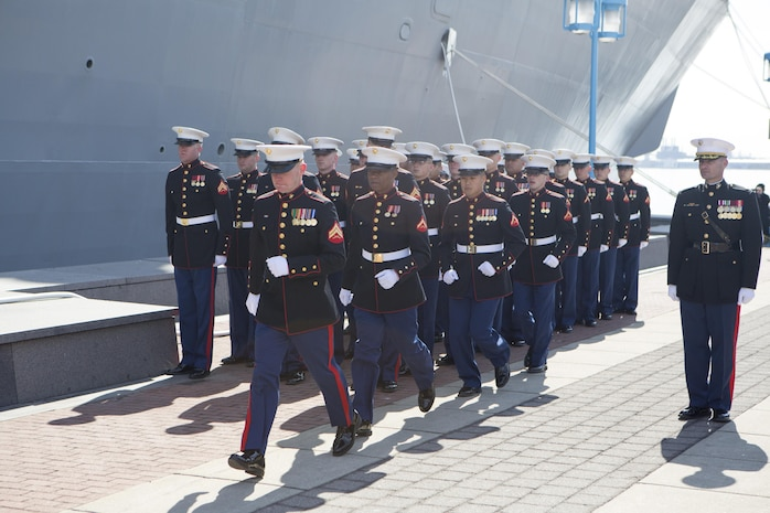 """US Marines with Combat Logistics Regiment 25, 2nd Marine Logistics Group, run aboard the USS Somerset (LPD 25) after being given the command by the ships sponsor, Mary Jo Myers, March 1, 2014 at Penn's Landing, Philadelphia, Pa. It is tradition at commissioning ceremonies for the ships sponsor to give the command, """"Man the ship and bring her to life!"""" (U.S. Marine Corps photo by Cpl. William M. Kresse / Released)"""