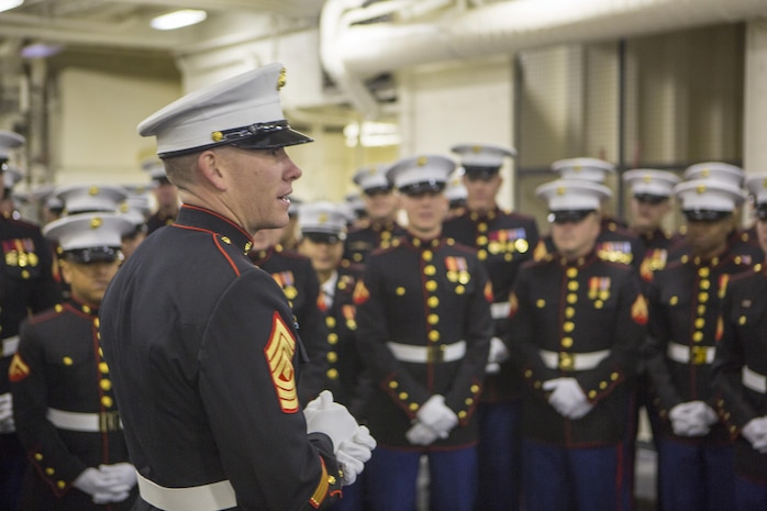 1st Sgt. Leon M. Banta, a US Marine with 8th Engineer Support Battalion, Combat Logistics Regiment 25, 2nd Marine Logistics Group, addresses Marines before the commissioning ceremony of USS Somerset (LPD 25) March 1, 2014. USS Somerset is the newest San Antonio class amphibious transport ship and it was named to honor the passengers of United Airlines Flight 93 that crashed in Somerset County on September 11, 2001. (U.S. Marine Corps photo by Cpl. William M. Kresse / Released)