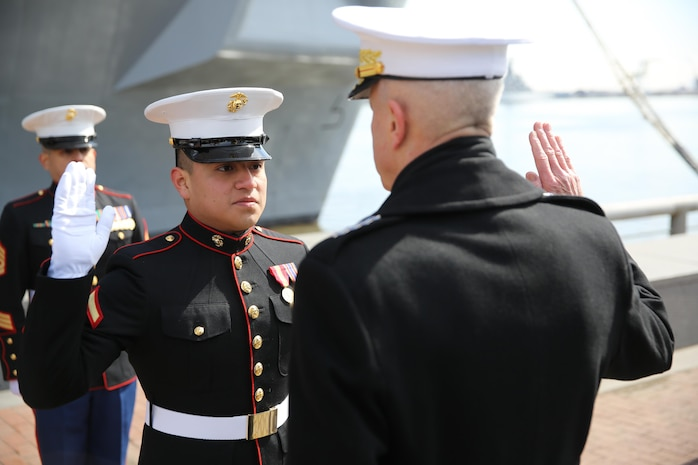 Gen. James F. Amos (right), the 35th Commandant of the Marine Corps, gives the oath of enlistment to Lance Cpl. Uriel Reyes Jr. (left), a Santa Ana, Calif., native and school clerk for Headquarters and Support Company, 8th Engineer Support Battalion, 2nd Marine Logistics Group, during a promotion ceremony at Penn's Landing, Philadelphia, March 1, 2014. The commandant promoted Reyes after the commissioning ceremony for the USS Somerset, named in honor of the passengers of United Airlines Flight 93, who fought terrorist attempts to hijack their plane on Sept. 11, 2001.