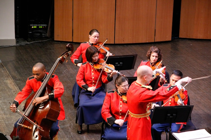 "On March 2, 2014, the Marine Chamber Orchestra performed a concert titled ""Homage to the Godfathers"" at the Rachel M. Schlesigner Concert Hall at Northern Virginia Community College in Alexandria, Va. Conducted by Major Jason K. Fettig, the concert featured Master Sgt. Aaron Clay performing Nina Rota's Divertimento Concertante.(U.S. Marine Corps photo by Staff Sgt. Rachel Ghadiali/released)"