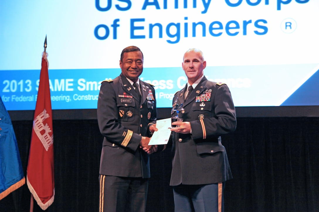 Lt. Gen. Thomas Bostick (left), commanding general of the U.S. Army Corps of Engineers, presents the AbilityOne Award to Col. Alan Dodd, commander of Jacksonville District, at the 2013 Society of American Military Engineers Small Business Conference in Kansas City, Mo. The district was recognized for awarding $2.9 million in contracts to AbilityOne nonprofit agencies, the second highest dollar amount awarded to AbilityOne contractors by a Corps district.