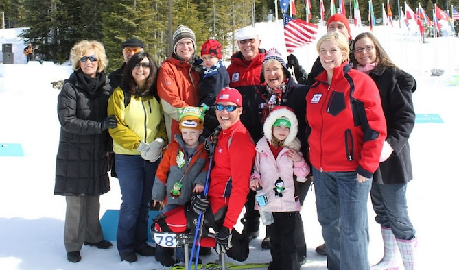 Surrounded by his family, Sean Halsted poses for a picture during the 2010 Vancouver Paralympic Winter Games.   Halsted, a former senior airman, was injured during a training exercise in 1998.  He is scheduled to compete in the Sochi Paralympic Winter Games starting on March 6, 2014. (Courtesy photo/Tech. Sgt. Regan Halsted)