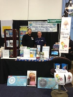 Adam Tarplee, natural resources program manager (left) and Chris Abernathy (right) of the U.S. Coast Guard Auxiliary partnered with Anna Stewart of the Drowning Prevention Coalition of Palm Beach County to educate the public about water safety at the South Florida Fair.