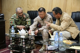 Brigadier Gen. Daniel D. Yoo, center, Regional Command (Southwest) commanding general, discusses the upcoming Afghan presidential elections with 215th Corps Chief of Staff, Brig. Gen. Zamen Hassan, left, during a security shura held aboard Forward Operating Base Delaram, Nimroz province, Afghanistan, March 4, 2014. They also discussed the polling stations and the security measures they are preparing in order to keep the people of Nimroz province safe.