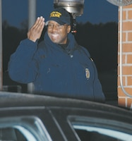 Zachary Robinson, police officer, Marine Corps Police Department, Public Safety Division, Marine Corps Logistics Base Albany, greets Tuesday morning traffic with a smile as personnel enter the Main Gate.