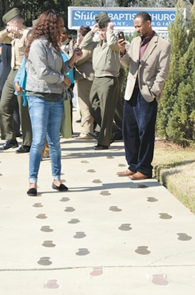 A base employee retraces footprints of the Albany civil rights movement outside of the Shiloh Baptist Church in Albany, Ga., Feb. 28 during a professional military education tour at the Albany Civil Rights Institute.