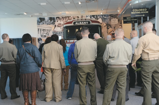 About 50 base personnel view a wall containing information about the civil rights movement during a professional military education tour Feb. 28 at the Albany Civil Rights Institute, Albany, Ga.