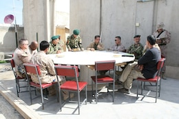 Brigadier Gen. Daniel D. Yoo, center-right, Regional Command (Southwest) commanding general, sits with 215th Corps Chief of Staff, Brig. Gen. Zamen Hassan, right of Brig. Gen. Yoo, Marine Expeditionary Brigade - Afghanistan staff, Marines with Security Force Assistance Advisor Team 4-215 and Afghan officials during a security shura aboard Forward Operating Base Delaram, Nimroz province, Afghanistan, March 4, 2014. During the shura, the Marines and Afghan officials discussed the upcoming presidential election and security measures being emplaced to ensure the safety of the local people.