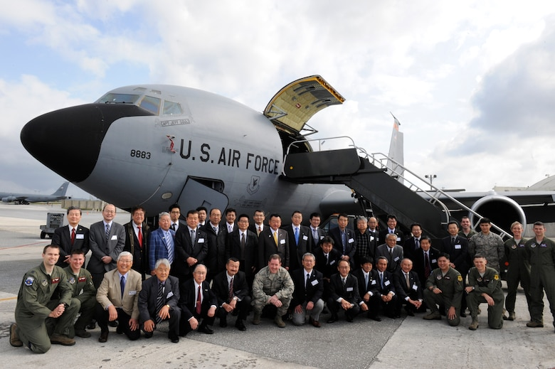 U.S. Air Force Brig. Gen. James Hecker, 18th Wing commander, poses for a group photo with members of the Japan-American Air Force Goodwill Association in front of a KC-135 Stratotanker on Kadena Air Base, Japan, March 5, 2014. During the visit, Kadena Airmen briefed JAAGA members from mainland Japan on the different capabilities the base provides as they toured different aircraft from the F-15 Eagle and F-22 Raptor to the HH-60 Pave Hawk helicopter and KC-135 Stratotanker. (U.S. Air Force photo by Senior Airman Maeson L. Elleman)