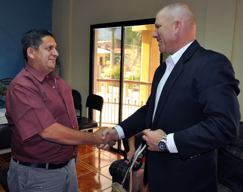 "U.S. Army Col. Thomas Boccardi is greeted by Mario Palencia, Mayor of Ajuterique, during a visit to Ajuterique, Honduras, March 5, 2014.  Boccardi spent the afternoon visiting with local leaders and discussing building on the strong relationship between Joint Task Force-Bravo and the local communities surrounding Soto Cano Air Base. Boccardi also presented the mayor with a collection of soccer balls and jerseys on behalf of the non-profit organization ""Kick for Nick.""(U.S. Air Force photo by Capt. Zach Anderson)   (U.S. Air Force photo by Capt. Zach Anderson)"
