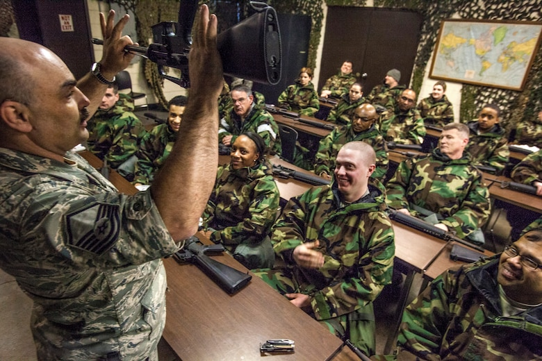 Master Sgt. John N. Charyk, left, instructs Airmen on how to disassemble an M16 rifle as Airmen from the 108th Wing, New Jersey Air National Guard, brush up on their chemical, biological, radiological and nuclear; self-aid buddy care; post attack reconnaissance and disassembling and reassembling Beretta M9 pistol and M16 rifle skills during the Wing's Ability to Survive and Operate Rodeo at Joint Base McGuire-Dix-Lakehurst, N.J. Feb. 9, 2014. The Wing-level evaluation shows what training areas need more focus. ATSO is used by Airmen who are deploying or preparing for exercises or inspections. These skills make up the foundation necessary for all Airmen to function effectively in hostile environments. (U.S. Air National Guard photo by Master Sgt. Mark C. Olsen/Released)
