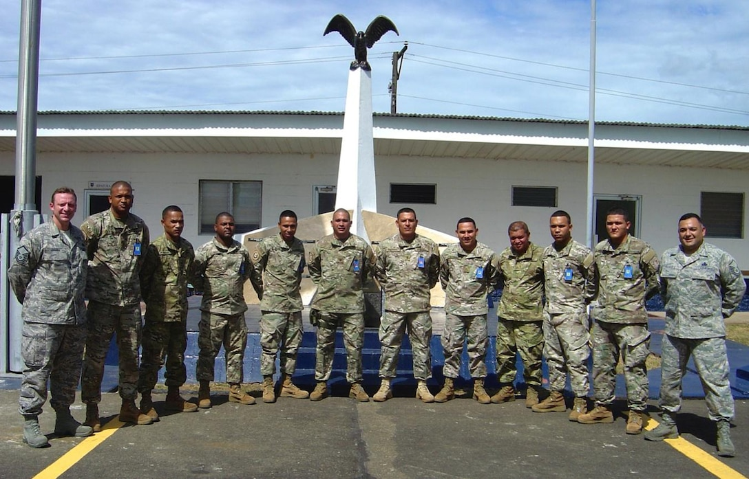 (Left) Master Sgt. Jeremy Jacobs, 12th Air Force (Air Forces Southern) Tactical Aircraft Manager, and Master Sgt. Roberto Vasquez, 12th Air Force (Air Forces Southern) A3/5 Superintendent, took part in the 20 day temporary duty assignment aimed at building partner capability pose for a photo with their Panamanian counterparts.