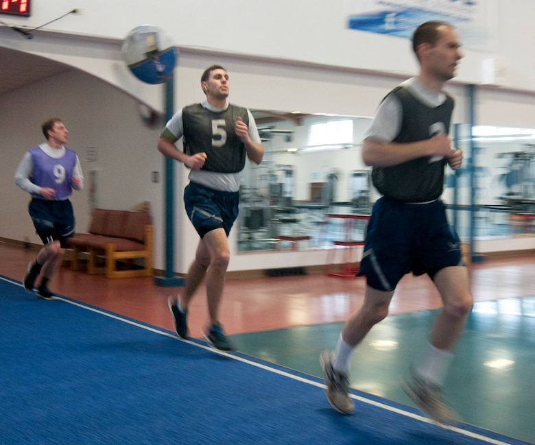 Airmen run the track in the Independence Hall Fitness Center on F.E. Warren Air Force Base, Wyo., March 4, 2014, during the timed run portion of their Air Force fitness assessment. The timed run, which accounts for 60 percent of the possible points Airmen can score on the assessment, is the portion of the assessment with which most Airmen struggle. The 90th Force Support Squadron Fitness Improvement Program aims to help Airmen improve their assessment scores, so cardio training is an important part of the program, which will help Airmen score higher on the timed run portion of the test. (U.S. Air Force photo by Airman 1st Class Jason Wiese)