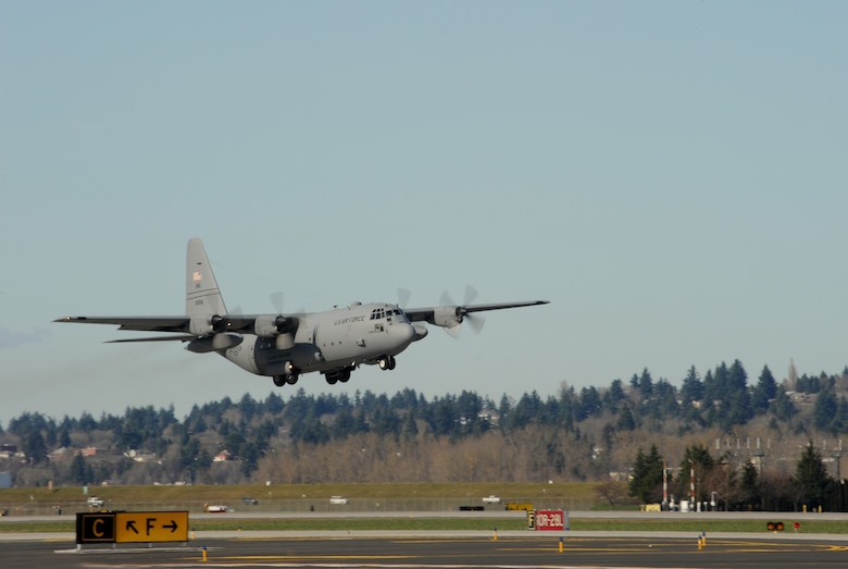 An Alaska Air National Guard C-130 Hercules aircraft leaves the Portland Air National Guard Base, Ore., prior to departing for Nellis Air Force Base, Nev., Feb. 28, 2014. (U.S. Air National Guard photo by Tech. Sgt. John Hughel/Released)