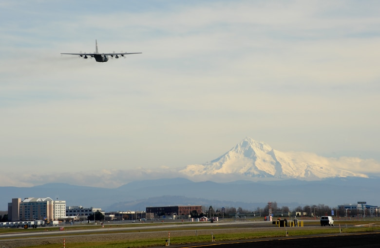 A Texas Air National Guard C-130 Hercules aircraft leaves the Portland Air National Guard Base, Ore., prior to departing for Nellis Air Force Base, Nev., Feb. 28, 2014. (U.S. Air National Guard photo by Tech. Sgt. John Hughel/Released)