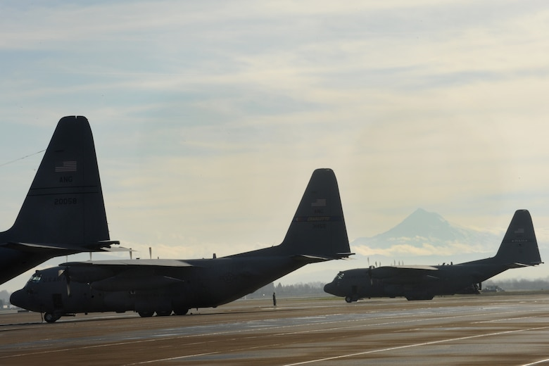 Several C-130 Hercules aircraft wait for cargo loads at the Portland Air National Guard Base, Ore., prior to departing for Nellis Air Force Base, Nev., Feb. 28, 2014. (U.S. Air National Guard photo by Tech. Sgt. John Hughel/Released)