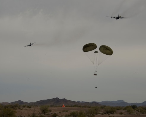 Airmen from the 109th Airlift Squadron conduct a low-cost, low-altitude airdrop in Yuma, Ariz. Feb., 25, 2014. The Airmen are making use of the warm climate to accomplish six-months of airdrops and other annual training requirements in a six-day time period.