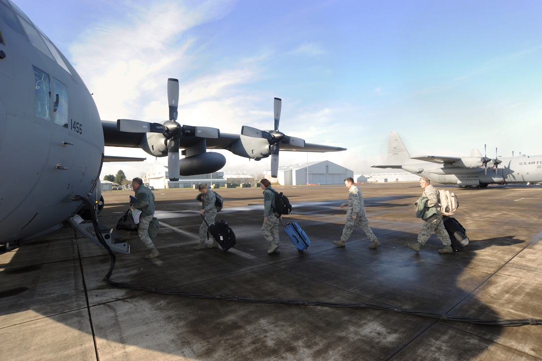 Members of the 142nd Fighter Wing board a C-130 Hercules at the Portland Air National Guard Base, Ore., prior to departing for Nellis Air Force Base, Nev., Feb. 28, 2014. (U.S. Air National Guard photo by Tech. Sgt. John Hughel/Released)