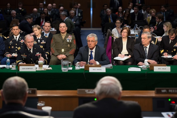 Secretary of Defense Chuck Hagel, Chairman of the Joint Chiefs of Staff Gen. Martin E. Dempsey and Defense Department's comptroller Robert F. Hale, testify before the Senate Armed Services Committee in Washington D.C. March 5, 2013. President Barack H. Obama presented a $3.9 trillion dollar budget plan for Fiscal Year 2015 this week of which $496 billion are allocated for the Defense Department.