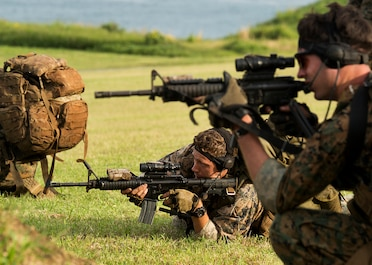 Sgt. Scott Hulsizer (center), a team leader with second platoon, Bravo Company, 3rd Reconnaissance Battalion, 3rd Marine Division, based in Okinawa, Japan, provides suppressive fire for his squad during a live-fire immediate action drill at the Kaneohe Bay Range Training Facility, March 3, 2014. 3rd Recon Bn. fired multiple weapon systems as part of a two day weapons package for Exercise Sandfisher. (U.S. Marine Corps photo by Lance Cpl. Matthew Bragg)