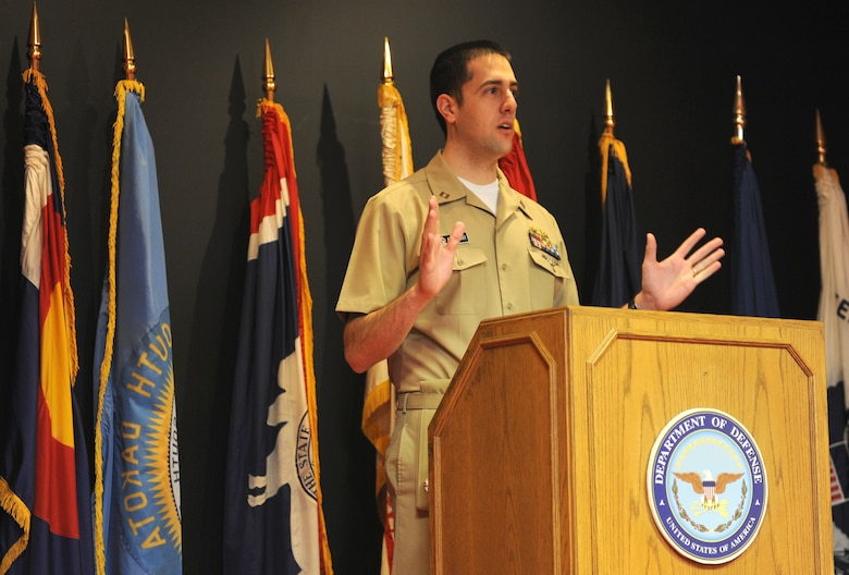 U.S. Navy Lt. Joseph Abdullah, Denver Military Entrance Processing Station operations officer, speaks with the applicants after their Oath of Enlistment ceremony March 4, 2014, at the Denver MEPS in Denver. The Oath of is given to any person enlisting or re-enlisting for a term of service into any branch of military. (Air Force photo by Emily E. Amyotte/Released)