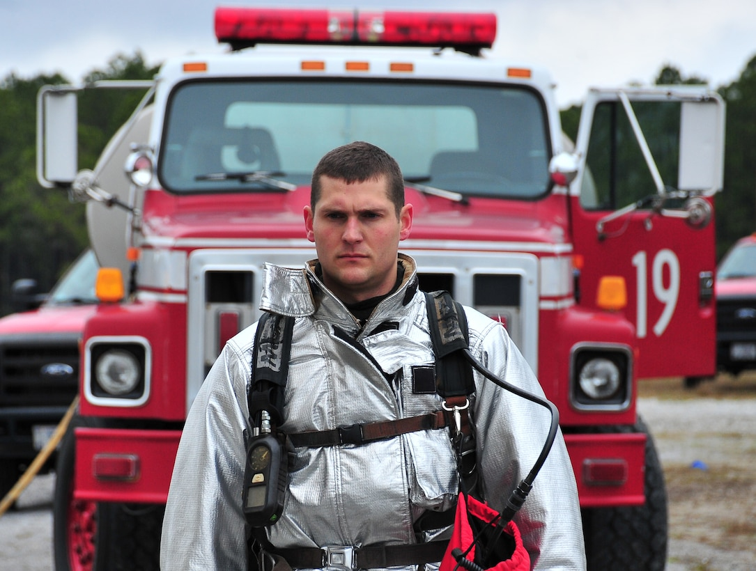 Airman 1st Class Bradley Gettel, 325th Civil Engineer Squadron fire and emergency services fire protection apprentice, stands in front of a firefighter vehicle March 7 at the Fire Department Training area. Gettel conducts firefighting operations on a four-man crew charged with structural and aircraft rescue firefighting and  provides support if hazardous material and technical rescue response is needed. (U.S. Air Force photo by Airman 1st Class Sergio A. Gamboa)
