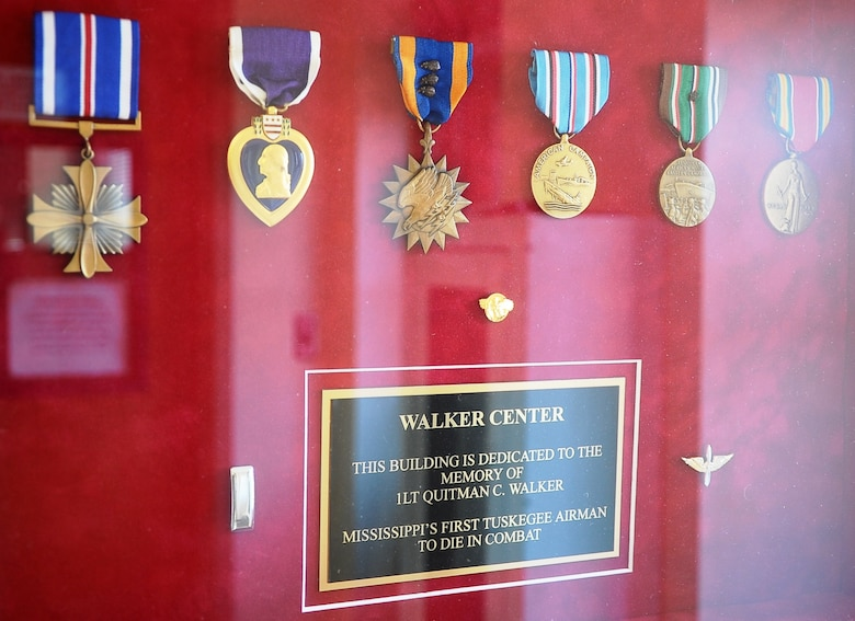 A shadowbox inside Walker Center holds 1st Lt. Quitman Walker's medals, his dedication plaque and a short biography. Walker was a Tuskegee Airman pilot who paid the ultimate price for his country. (U.S. Air Force Photo/Airman John Day)