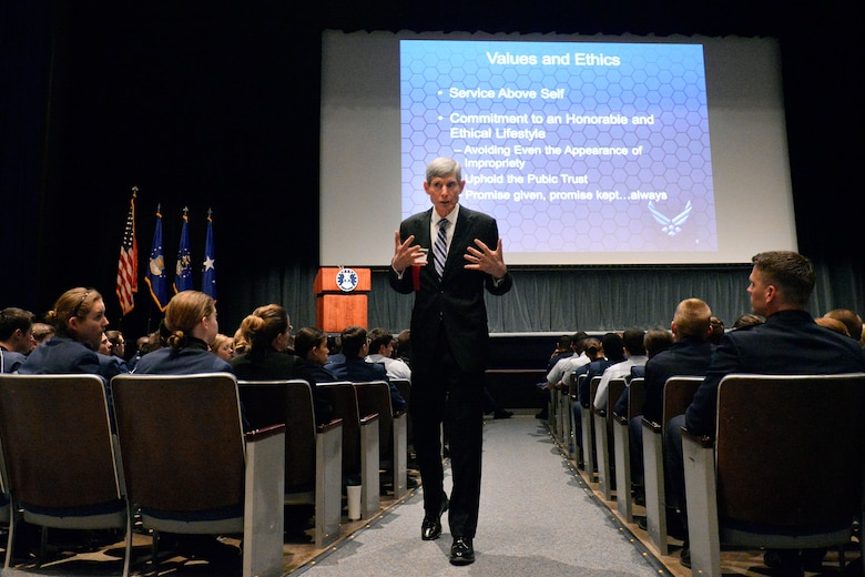 Retired Gen. Norton Schwartz, 1973 Academy graduate, walks through an aisle of cadets and Academy staff as he speaks to them about values and ethics at the 2014 National Character and Leadership Symposium Feb. 28.