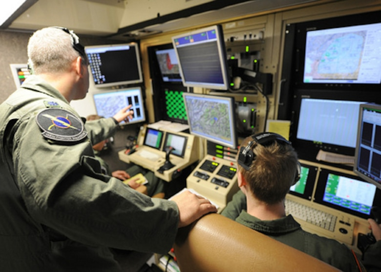 A student pilot and sensor operator man the controls of a MQ-9 Reaper in a ground-based cockpit during a training mission flown from Hancock Field Air National Guard Base, Syracuse, New York. (U.S. Air National Guard photo by Tech. Sgt. Ricky Best/Released)
