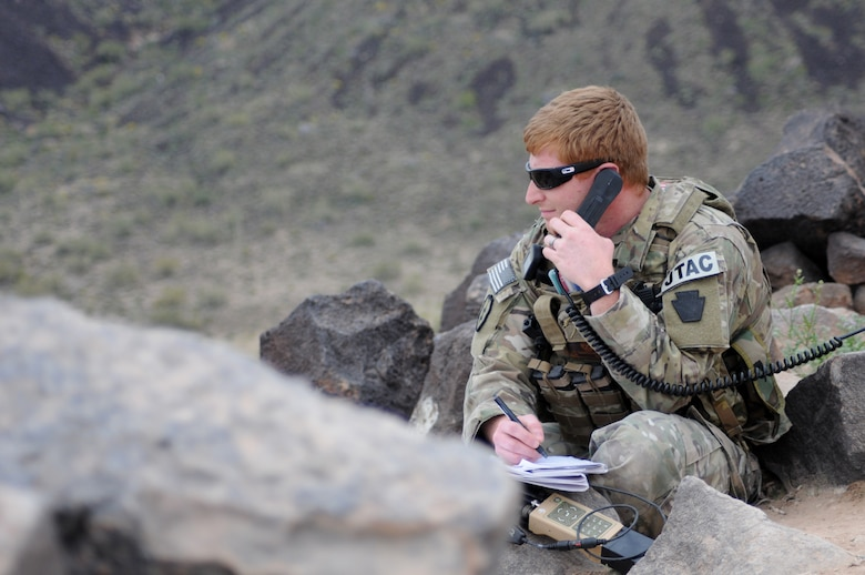 A picture of U.S. Air Force 2nd Lt. Keith A. Giamberardino, an air liaison officer, using a radio.