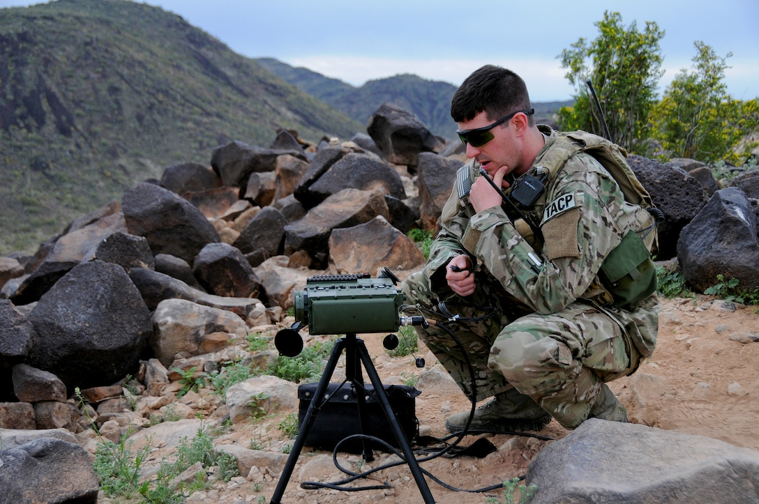 U.S. Air Force Tech. Sgt. Wayne White, a tactical air control party airman from the New Jersey Air National Guard's 177th Fighter Wing, uses a laser marker to coordinate an air strike Feb. 25 at the Barry Goldwater Air Force Range, Gila Bend Air Force Auxiliary Field, Ariz. (U.S. Air National Guard photo by Airman 1st Class Shane Karp/Released)