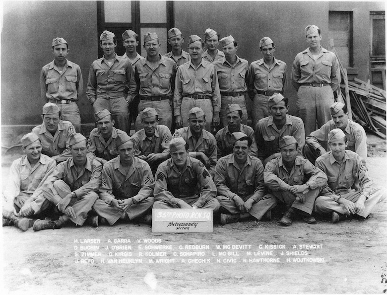 Members of the Redhawks, in the 35th Photo Reconnaissance Squadron's Photogrammetry Section, pose for a photo at Kunming, China, in October of 1944, shortly after arriving in-country.  H. Allen Larsen is seen at left in the very back row.