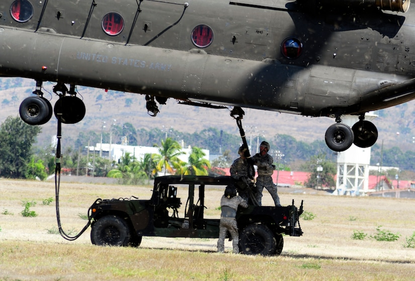 Members of Joint Task Force-Bravo conducted sling-load training at Soto Cano Air Base, Honduras, March 6, 2014. Sling-loading allows Task Force helicopters to transport extremely heavy loads, to include items such as vehicles, generators, and all types of cargo and supplies. (Photo by Martin Chahin)