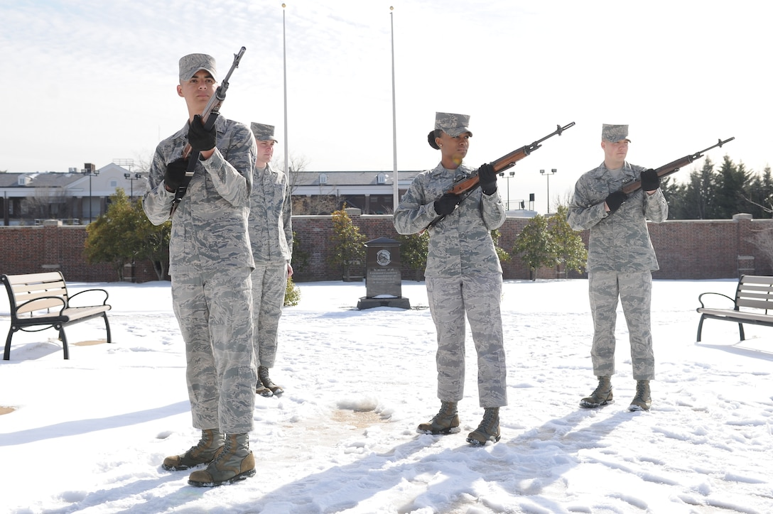 Airman 1st Class Grace Taylor (center) trains with members of the United States Air Force Honor Guard's firing party at Joint Base Anacostia-Bolling, Washington, D.C., on March 4, 2014. Taylor, a tech school instructor, is still fully qualified to be on the firing party. The firing party performs the firing of three volleys during funeral services at Arlington National Cemetery. (U.S. Air Force photo/Airman 1st Class Ryan J. Sonnier)