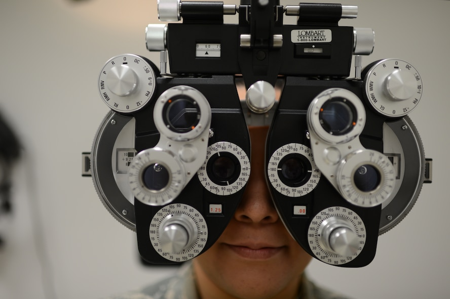 U.S. Air Force Senior Airman Ivonn Zepeda Chavez, 52nd Aerospace Medicine Squadron optometry technician from Wichita, Kan., looks through a phoropter at Spangdahlem Air Base, Germany, March 5, 2014. Optometry technicians use equipment like the phoropter to determine a patient's prescription. (U.S. Air Force photo by Senior Airman Gustavo Castillo/Released)