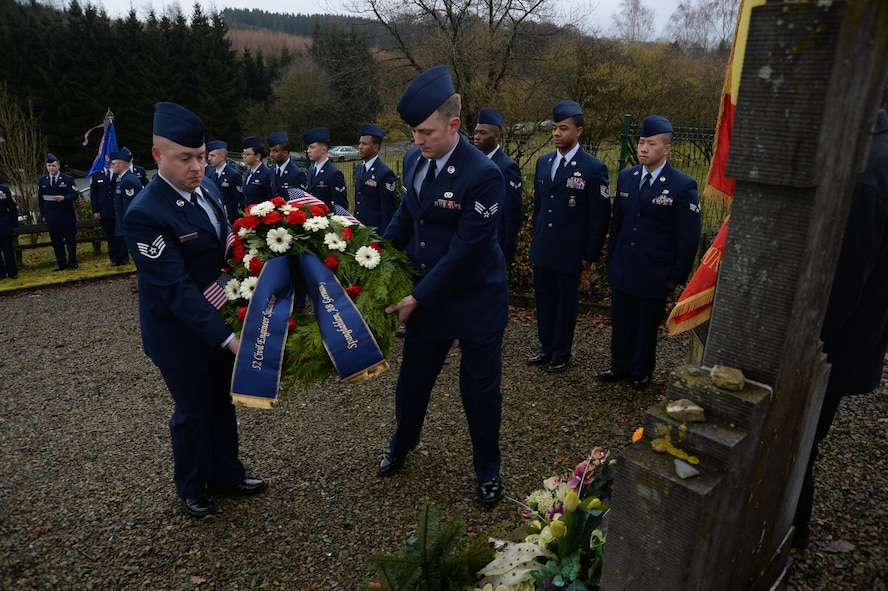 U.S. Air Force Staff Sgt. Christopher Anderson, left, and Senior Airman Brian Wintemberg, center, both from the 52nd Civil Engineer Squadron, Spangdahlem Air Base, Germany, prepare to lay a wreath during at the Wereth 11 Memorial site in Wereth, Belgium, Feb. 28, 2014. Airmen from the 52nd CES conducted the ceremony on the last day of Black History Month to honor the legacy of 11 African-American Soldiers killed during the Battle of the Bulge in December 1944. (U.S. Air Force photo by Staff Sgt. Joe W. McFadden / Released)