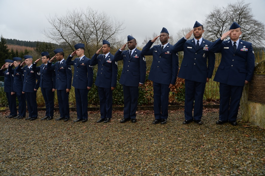 Eleven U.S. Air Force Airmen from the 52nd Civil Engineer Squadron, Spangdahlem Air Base, Germany, salute during a ceremony at the Wereth 11 Memorial site in Wereth, Belgium, Feb. 28, 2014. More than 20 Spangdahlem Airmen conducted the ceremony to honor the legacy of 11 African-American Soldiers killed during the Battle of the Bulge in December 1944. (U.S. Air Force photo by Staff Sgt. Joe W. McFadden / Released)