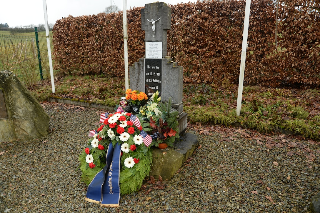 A wreath placed by members of the 52nd Civil Engineer Squadron, Spangdahlem Air Base, Germany, rests at the Wereth 11 Memorial site in Wereth, Belgium, Feb. 28, 2014. More than 20 Spangdahlem Airmen conducted the memorial ceremony, complete with a recording of a ceremonial volley and playing of the Belgian and U.S. national anthems, to honor the legacy of the 11 African-American Soldiers who were killed during the Battle of the Bulge in December 1944. (U.S. Air Force photo by Staff Sgt. Joe W. McFadden / Released)