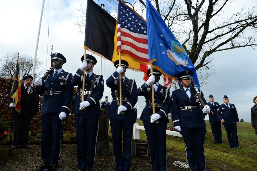 Spangdahlem Air Base Honor Guard members present the Belgian, U.S. and U.S. Air Force flags during a ceremony at the Wereth 11 Memorial site in Wereth, Belgium, Feb. 28, 2014. Spangdahlem Airmen conducted the service to honor the legacy of 11 African-American Soldiers killed during the Battle of the Bulge in December 1944. (U.S. Air Force photo by Staff Sgt. Joe W. McFadden / Released)