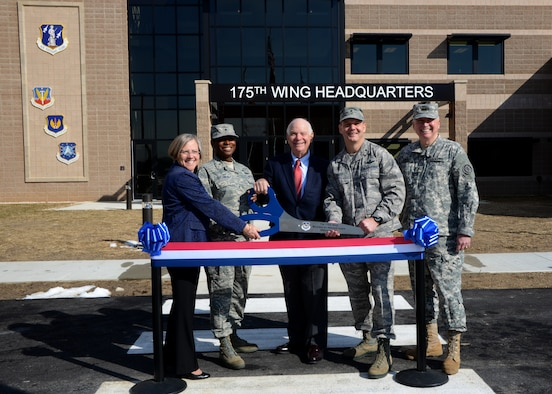 (L to R) Mrs. Barbara Nemcheck, Project Manager for Burns & McDonnell, U.S. Air Force Brig. Gen. Allyson Solomon, Assistant Adjutant General–Air, U.S. Sen. Benjamin Cardin, Maryland, U.S. Air Force Brig. Gen. Scott Kelly, 175th Wing Commander and U.S. Army Maj. Gen. James Adkins, Adjutant General Maryland National Guard, come together during a ribbon cutting ceremony to celebrate the grand opening of the new 175th Wing headquarters building, March 8, 2014, at Warfield Air National Guard Base, Baltimore, Md.  The new facility is the home of the 175th Wing Leadership, Mission Support Group, Medical Group and other wing support functions.  (U.S. Air National Guard photo by Tech. Sgt. Chris Schepers/RELEASED)