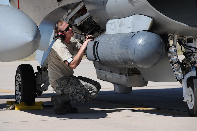 U.S. Air Force Senior Airman Mike Klinger, a crew chief with the 177th Fighter Wing, inspects the aircraft prior to takeoff Feb. 27 at Davis-Monthan Air Force Base in Tucson, Ariz. Airmen from the 177th trained at Operation Snowbird, a training facility that offers ideal conditions for U.S. military flying units. (U.S. Air National Guard photo by Airman 1st Class Shane Karp/Released)