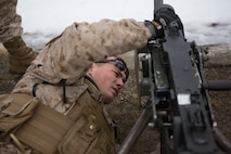 U.S. Marine Cpl. Kahl Harmon, an Alta Loma, Calif, native and acting platoon sergeant with Weapons Company, 2nd Battalion, 2nd Marine Regiment, 2nd Marine Division inspects a .50 caliber machine gun prior to a live fire range March 6, 2014. Marines and Norwegian soldiers spent the day learning each other's weapons systems and training together prior to exercise Cold Response 2014, which is a multinational and multilateral training exercise. The exercise will feature various types of military training including maritime, land and air operations. The location, above the Arctic Circle in northern Norway, provides a unique cold-weather environment for all forces involved to learn and develop procedures from one another.