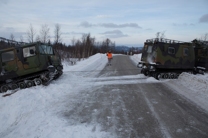 A Bandvagn 206 tows a broken down BV to a road to move it to a repair locaton. Marines with Company G, 2nd Battalion, 2nd Marine Regiment, 2nd Marine Division and Norwegian soldiers from Host Nation Support Battalion spent three days learning to work together and how to operate in the Norwegian winter environment to prepare the Marines and soldiers for Exercise Cold Response, which is a multinational and multilateral training exercise. The exercise will feature various types of military training including maritime, land and air operations. The location, above the Arctic Circle in northern Norway, provides a unique cold-weather environment for all forces involved to learn and develop procedures from one another.